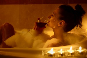 A Relaxing Bubble Bath With Candles And Wine